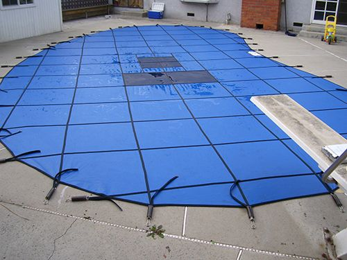 A blue mesh pool cover