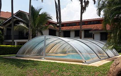 A retractable swimming pool enclosure