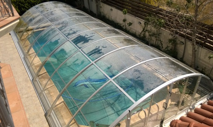 Bubble Pool Cover Vs Polycarbonate Pool Enclosure The